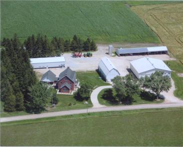 A late-2000s aerial shot of the home farm.