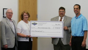 Farm owners Benjamin and Lisa Riensche formally presented a check to SSNHA Chairman Troy Louwagie and President Don Short.