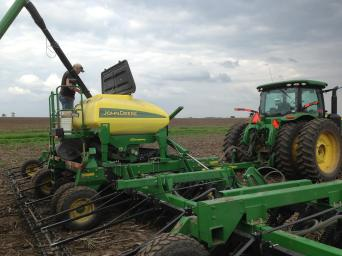 Filling the soybean drill.