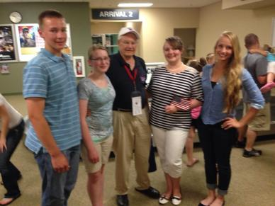 Welcoming Grandpa Roland home from Honor Flight!