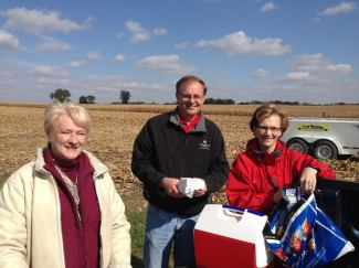 Lisa Riensche with Farm Credit reps, who brought lunch to the field.